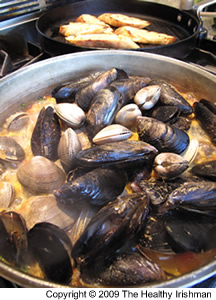 The mussels and clams are cooked when all the shells have opened, 4-5 minutes. Don't overcook them!