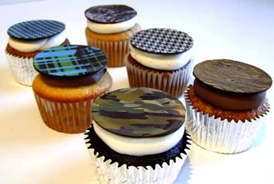 Butch cupcakes are topped  with a macho chocolate disk like the Woodland Camo, Wood Grain,  Houndstooth, Plaid, Checkerboard, or Marble.